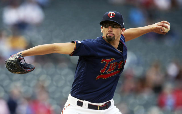Minnesota Twins pitcher Devin Smeltzer, making his Major League debut, throws against the Milwaukee Brewers in the first inning of a baseball game, Tuesday, May 28, 2019, in Minneapolis. (AP Photo/Jim Mone)