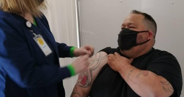 John Harrower, a truck driver based in Brandon, Man., got the first dose of his COVID-19 vaccine at a pop-up site in North Dakota on Thursday.