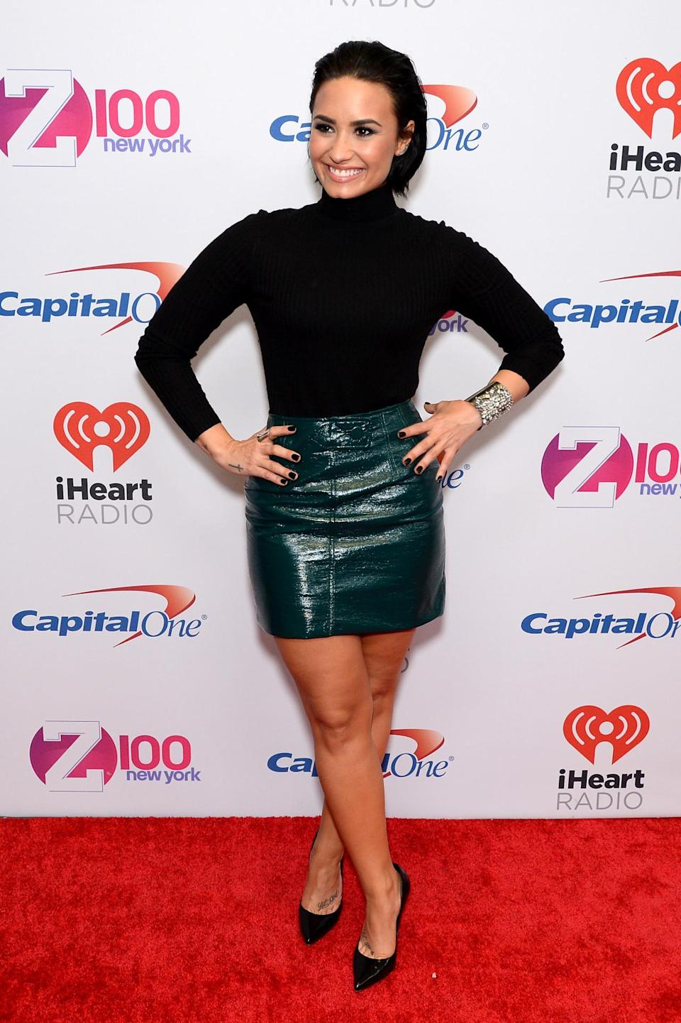 <p>The singer kept things pretty simple in a black turtleneck, pumps and a textured green skirt. She slicked back her bob to complete the look and also remind us just how darn good she looks with shorter hair.</p>