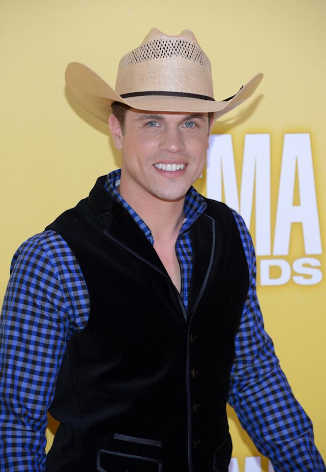"<p class=""MsoNormal"">""Cowboys and Angels"" singer Dustin Lynch went country casual in a bright blue-and-black checked shirt topped off by a velvet vest and cowboy hat. (11/1/2012)</p>"