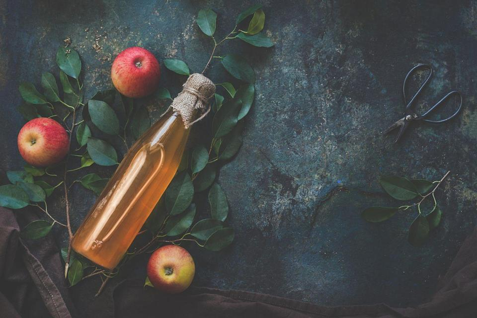 """<p>If you've noticed your hair limp lately, there's a chance there's too much product buildup in your hair, but don't fret. With this natural product removal, you can bring life back to your hair. </p><p><strong>To use: </strong>You'll need apple cider vinegar <a href=""""https://www.healthline.com/nutrition/6-proven-health-benefits-of-apple-cider-vinegar#1.-High-in-healthful-substances"""" rel=""""nofollow noopener"""" target=""""_blank"""" data-ylk=""""slk:with the mother"""" class=""""link rapid-noclick-resp"""">with the mother</a>, a substance that, according to Healthline, contains strands of proteins, enzymes, and friendly bacteria. Combine the vinegar with rosemary oil and rinse. It will """"bring out all of the dirt and build up in your hair and braids,"""" Nigerian American celebrity hairstylist <a href=""""https://www.instagram.com/hairbysusy/"""" rel=""""nofollow noopener"""" target=""""_blank"""" data-ylk=""""slk:Susan Oludele"""" class=""""link rapid-noclick-resp"""">Susan Oludele</a>, founder of <a href=""""https://www.hairbysusy.com/"""" rel=""""nofollow noopener"""" target=""""_blank"""" data-ylk=""""slk:Hair by Susy"""" class=""""link rapid-noclick-resp"""">Hair by Susy</a>, tells Woman's Day.</p>"""