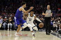 Memphis Grizzlies' Ja Morant (12) is defended by Los Angeles Clippers' Jerome Robinson during the second half of an NBA basketball game Saturday, Jan. 4, 2020, in Los Angeles. (AP Photo/Marcio Jose Sanchez)