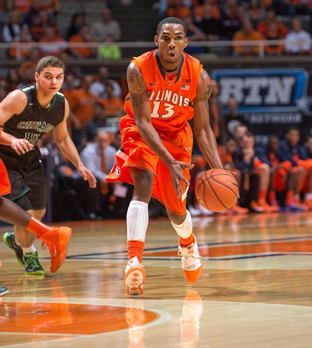 Illinois' Tracy Abrams (13) looks to pass the ball during the first half of an NCAA college basketball game against Chicago State, Friday, Nov. 22, 2013, in Champaign, Ill. (AP Photo/Darrell Hoemann)