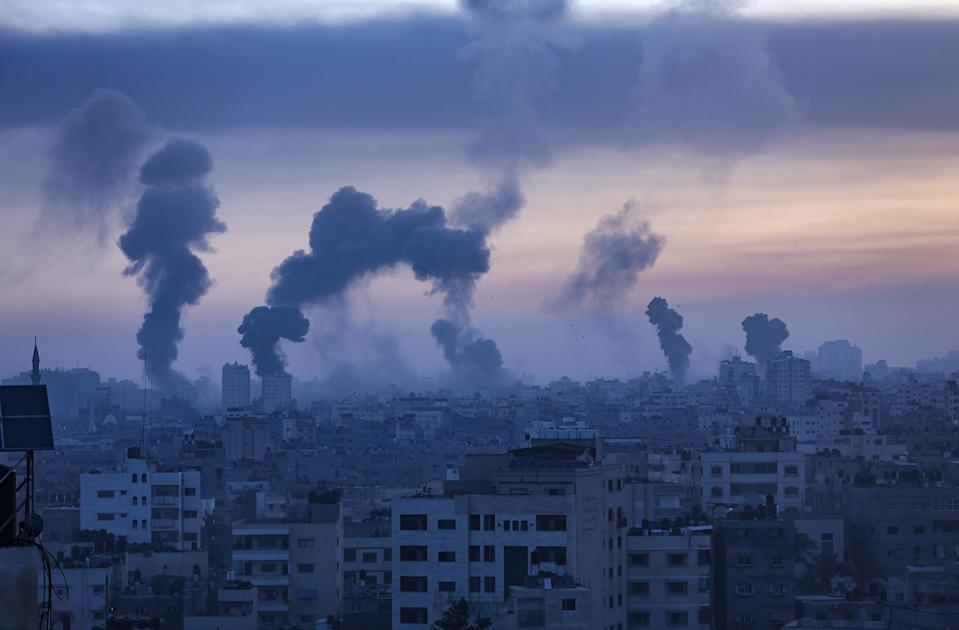 <p>Smoke and flames rise from Gaza City yesterday Wednesday</p> (EPA)