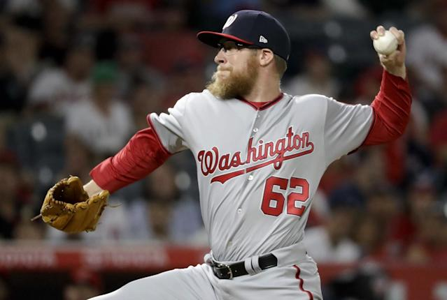 Sean Doolittle and Ryan Madson will try to help Washington's shaky bullpen. (AP Images)