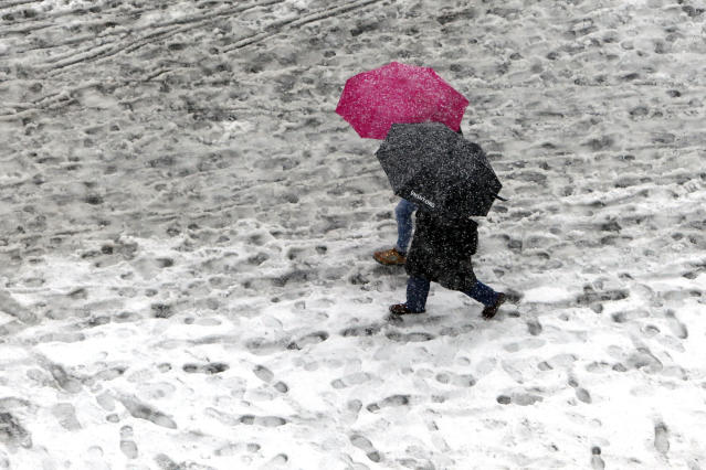 Pedestrians make prints in the snow and slush as they pass through Union Square Monday, Feb. 3, 2014, in New York. Another winter storm bears down on the eastern U.S., only a day after temperatures soared into the 50s. (AP Photo/Jason DeCrow) (AP Photo/Jason DeCrow)