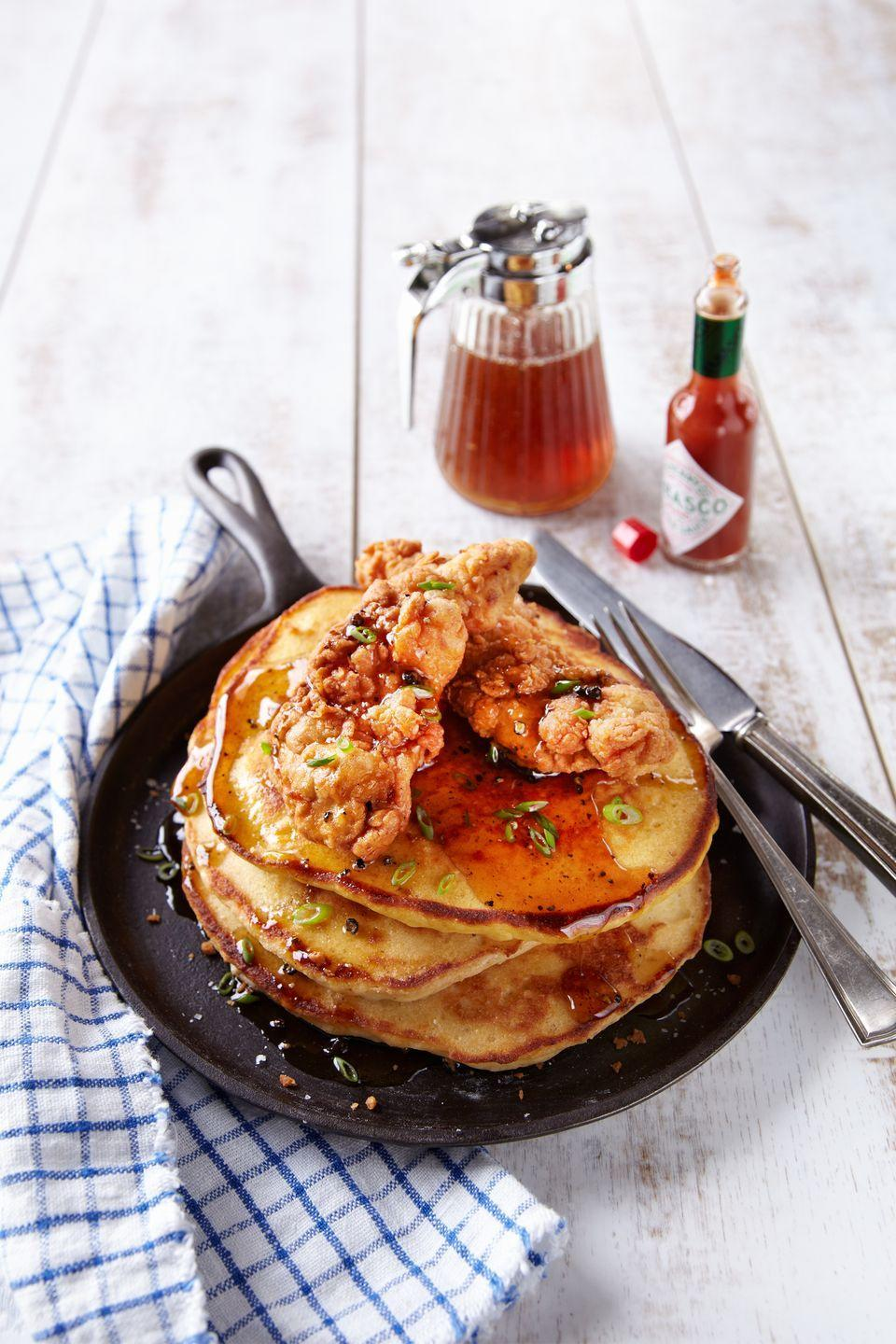"""<p>Eat breakfast for dinner! Avoid soggy chicken by placing just-fried chicken on a <a href=""""https://www.amazon.com/Stainless-Steel-Cooling-Rack-Commercial/dp/B00ZO6FTK6/?tag=syn-yahoo-20&ascsubtag=%5Bartid%7C10050.g.680%5Bsrc%7Cyahoo-us"""" rel=""""nofollow noopener"""" target=""""_blank"""" data-ylk=""""slk:cooling rack"""" class=""""link rapid-noclick-resp"""">cooling rack</a> allows air to circulate around it, resulting in perfectly crisp flapjack toppers.</p><p><strong><a href=""""https://www.countryliving.com/food-drinks/recipes/a37593/chicken-corn-bread-pancakes-spicy-syrup/"""" rel=""""nofollow noopener"""" target=""""_blank"""" data-ylk=""""slk:Get the recipe"""" class=""""link rapid-noclick-resp"""">Get the recipe</a>.</strong><br></p><p><a class=""""link rapid-noclick-resp"""" href=""""https://www.amazon.com/Stainless-Steel-Cooling-Rack-Commercial/dp/B00ZO6FTK6/?tag=syn-yahoo-20&ascsubtag=%5Bartid%7C10050.g.680%5Bsrc%7Cyahoo-us"""" rel=""""nofollow noopener"""" target=""""_blank"""" data-ylk=""""slk:SHOP COOLING RACKS"""">SHOP COOLING RACKS</a> </p>"""