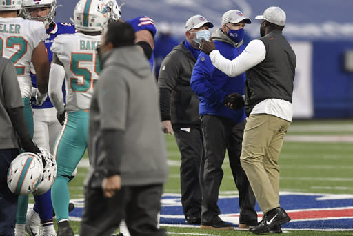 Buffalo Bills head coach Sean McDermott, second from right, meets with Miami Dolphins head coach Brian Flores, right, on the field after an NFL football game, Sunday, Jan. 3, 2021, in Orchard Park, N.Y. (AP Photo/Adrian Kraus)