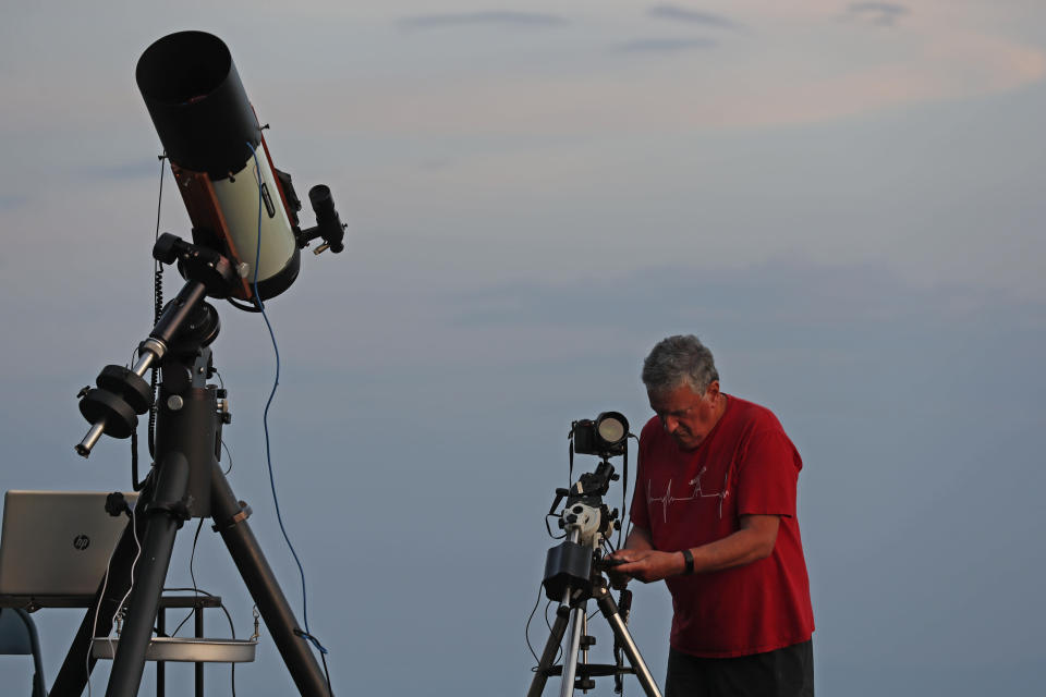 Johnny Horne, astrophotographer and amateur astronomer sets up his telscope and camera to photograph Comet NEOWISE at Grandfather Mountain in Linville, N.C., Friday, July 17, 2020. (AP Photo/Gerry Broome)