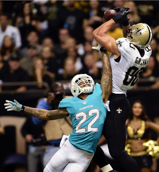 New Orleans Saints tight end Jimmy Graham (80) pulls in a touchdown reception over Miami Dolphins cornerback Jamar Taylor (22) in the first half of an NFL football game in New Orleans, Monday, Sept. 30, 2013. (AP Photo/Bill Feig)