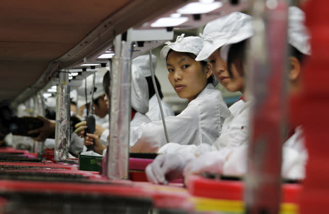 Workers are seen inside a Foxconn factory in the township of Longhua in the southern Guangdong province May 26, 2010. A spate of nine employee deaths at global contract electronics manufacturer Foxconn, Apple's main supplier of iPhones, has cast a spotlight on some of the harsher aspects of blue-collar life on the Chinese factory floor.   REUTERS/Bobby Yip  (CHINA - Tags: BUSINESS EMPLOYMENT)    FOR BEST QUALITY IMAGE ALSO SEE: GF2E9AP0D4F01 - GM1E65Q1D4Y01