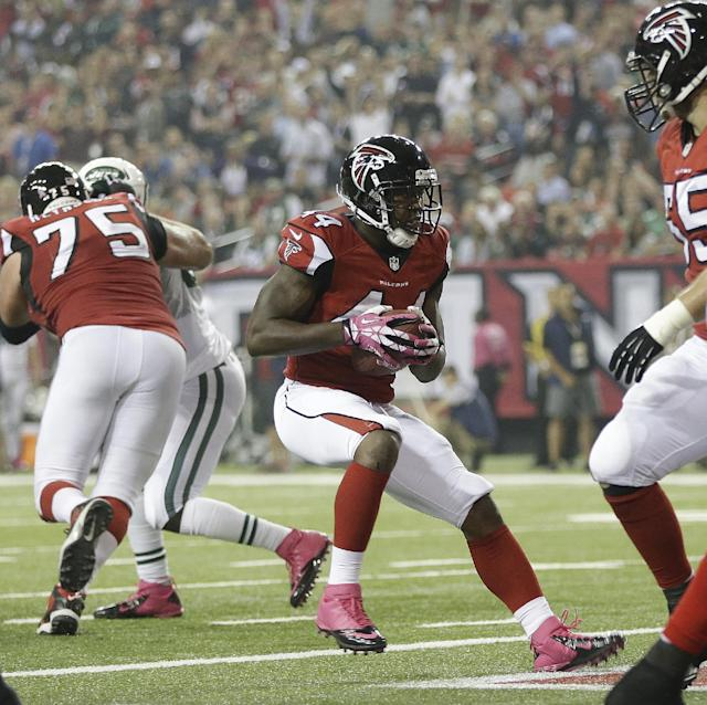 Atlanta Falcons fullback Jason Snelling (44) runs into the end zone for a touchdown against the New York Jets during the first half of an NFL football game, Monday, Oct. 7, 2013, in Atlanta. (AP Photo/John Bazemore)