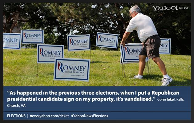 A supporter of U.S. Republican Presidential candidate Mitt Romney is pictured with signs at a campaign event at the Bavarian Inn Lodge in Frankenmuth, Michigan, June 19, 2012.