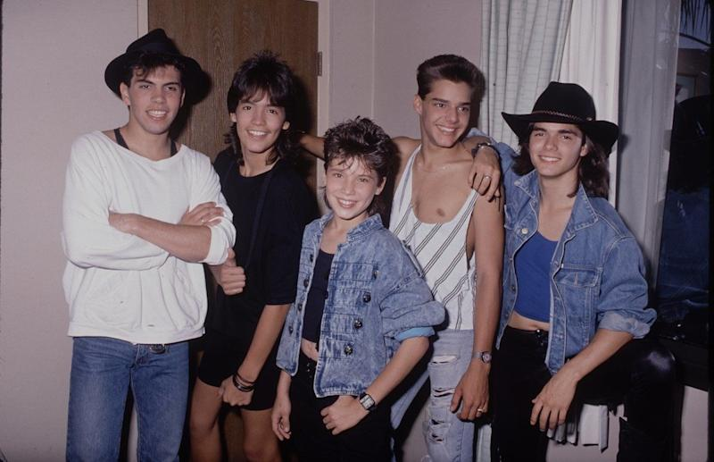 With his Menudo friends.