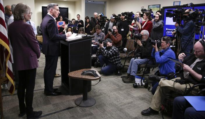 """<span class=""""caption"""">A county executive in Washington state addresses the media after a death from COVID-19, which results from the coronavirus.</span> <span class=""""attribution""""><a class=""""link rapid-noclick-resp"""" href=""""https://www.gettyimages.com/detail/news-photo/king-county-executive-dow-constantine-speaks-following-the-news-photo/1204218430?adppopup=true"""" rel=""""nofollow noopener"""" target=""""_blank"""" data-ylk=""""slk:Jason Redmond/AFP via Getty Images"""">Jason Redmond/AFP via Getty Images</a></span>"""