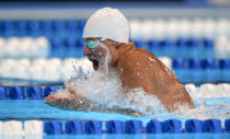 Ryan Lochte swims in the men's 400-meter individual medley preliminaries at the U.S. Olympic swimming trials, Monday, June 25, 2012, in Omaha, Neb. (AP Photo/Mark J. Terrill)