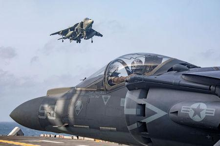 U.S. Marine Corps AV-8B Harriers return to the flight deck of the amphibious assault ship USS Kearsarge