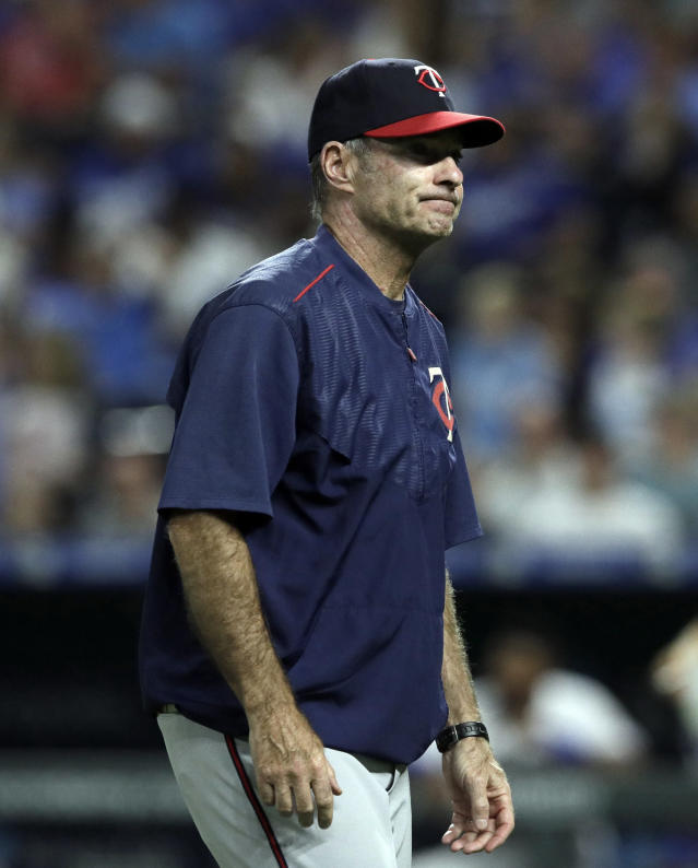 FILE - In this July 20, 2018, file photo, Minnesota Twins manager Paul Molitor grimaces during a baseball game against the Kansas City Royals, at Kauffman Stadium in Kansas City, Mo. The Twins announced Tuesday, Oct. 2, 2018, that Molitor will not return as manager in 2019. Molitor has been offered a position to stay with the organization in a Baseball Operations capacity and will consider the offer. (AP Photo/Orlin Wagner, File)