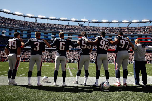 <p>New England Patriots players stand for the national anthem before their game against the Carolina Panthers at Gillette Stadium on October 1, 2017 in Foxboro, Massachusetts. (Photo by Jim Rogash/Getty Images) </p>