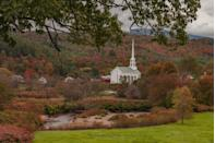 <p>Pretty church steeples standing tall among buildings and pretty foliage like this on in Stowe, Vermont look so inviting.</p>
