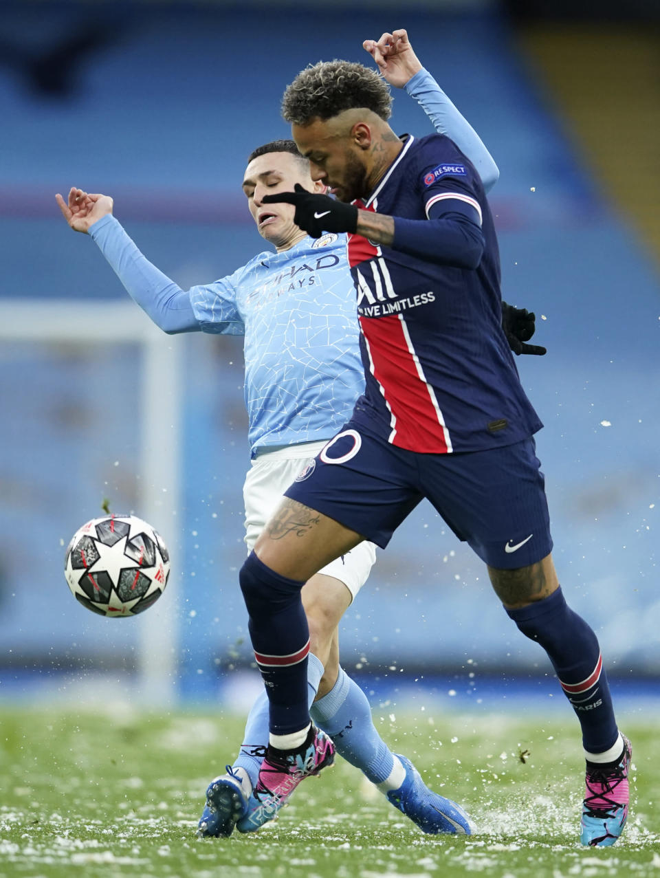 Manchester City's Phil Foden, left, challenges PSG's Neymar during the Champions League semifinal second leg soccer match between Manchester City and Paris Saint Germain at the Etihad stadium, in Manchester, Tuesday, May 4, 2021. (AP Photo/Dave Thompson)