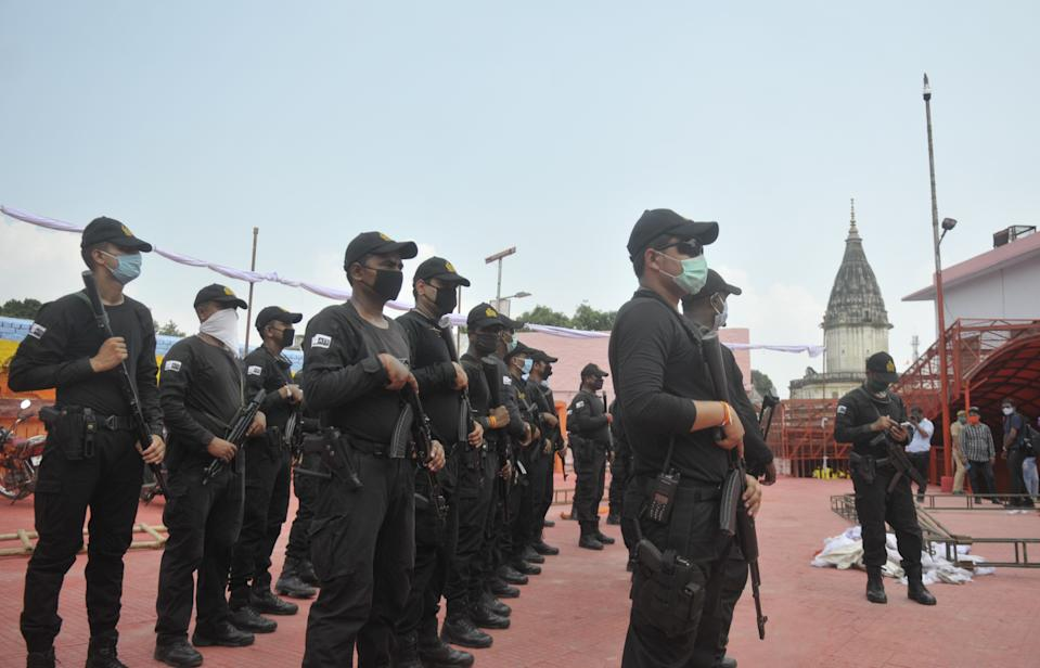 AYODHYA, INDIA - AUGUST 4: NSG commandos on alert at Hanuman Garhi temple on the eve of the foundation stone laying ceremony of the Ram Janmabhumi temple on August 4, 2020 in Ayodhya, India. Prime Minister Narendra Modi will on Wednesday attend a public function on laying of the foundation stone of 'Shree Ram Janmabhoomi Mandir' at Ayodhya. Ram Janmabhoomi Teerth Kshetra, the trust set up for the construction and management of Ram temple, has invited 175 eminent guests for the foundation stone-laying ceremony after personally discussing with BJP veterans L K Advani and Murli Manohar Joshi, lawyer K Parasaran and other dignitaries. (Photo by Deepak Gupta/Hindustan Times via Getty Images)