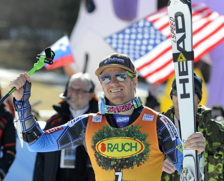 Ted Ligety, of the United States, smiles after winning an alpine ski, men's World Cup giant slalom in Kranjska Gora, Slovenia, Saturday, March 10, 2012. Ted Ligety won the season's penultimate World Cup giant slalom Saturday to keep alive his hopes of retaining the discipline title for another year. (AP Photo/Elvis Piazzi)