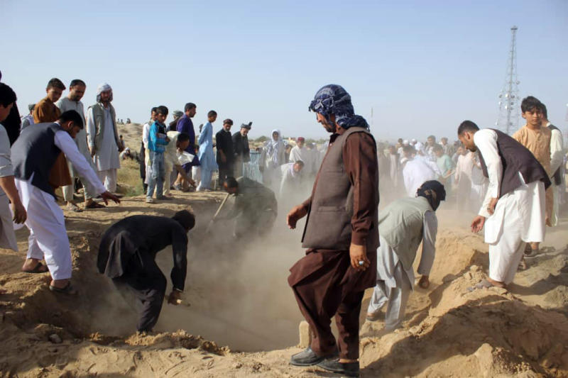 """Afghan men bury the bodies of security forces killed in a suicide attack on Saturday ,in Kunduz province, north of Kabul, Afghanistan, Sunday, Sept. 1, 2019. The Taliban attacked a second Afghan city in as many days on Sunday and killed several members of security forces, officials said, even as Washington's peace envoy said the U.S. and the militant group are """"at the threshold of an agreement"""" to end America's longest war. (AP Photo/Bashir Khan Safi)"""
