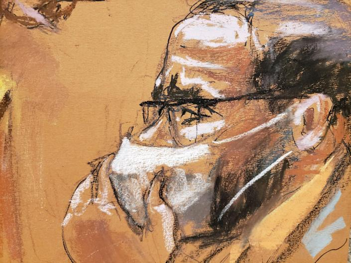A courtroom sketch of R. Kelly holding his hand to his facemask