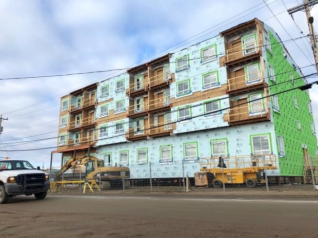 This housing complex is under construction in Iqaluit's downtown core. Tenders for housing projects this summer came back up to 40 per cent over budget, forcing them them to be delayed.  (Beth Brown/CBC - image credit)