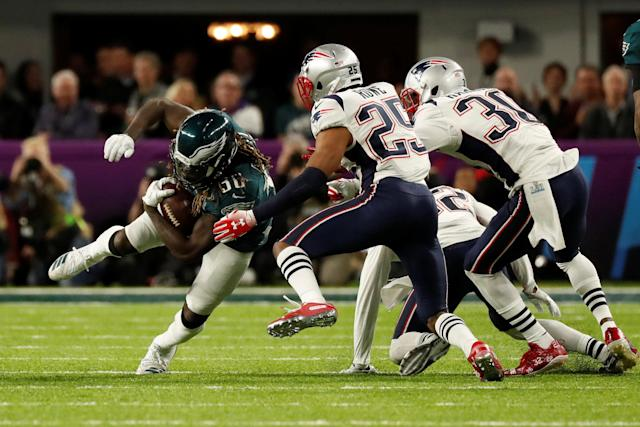 NFL Football - Philadelphia Eagles v New England Patriots - Super Bowl LII - U.S. Bank Stadium, Minneapolis, Minnesota, U.S. - February 4, 2018 Philadelphia EaglesÕ Jay Ajayi in action with New England Patriots' Eric Rowe and Duron Harmon REUTERS/Kevin Lamarque