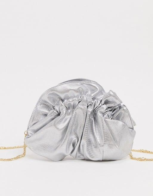 <p><span>ASOS Ruched Pouch Frame Clutch With Chain Strap</span> ($12, originally $29)</p>