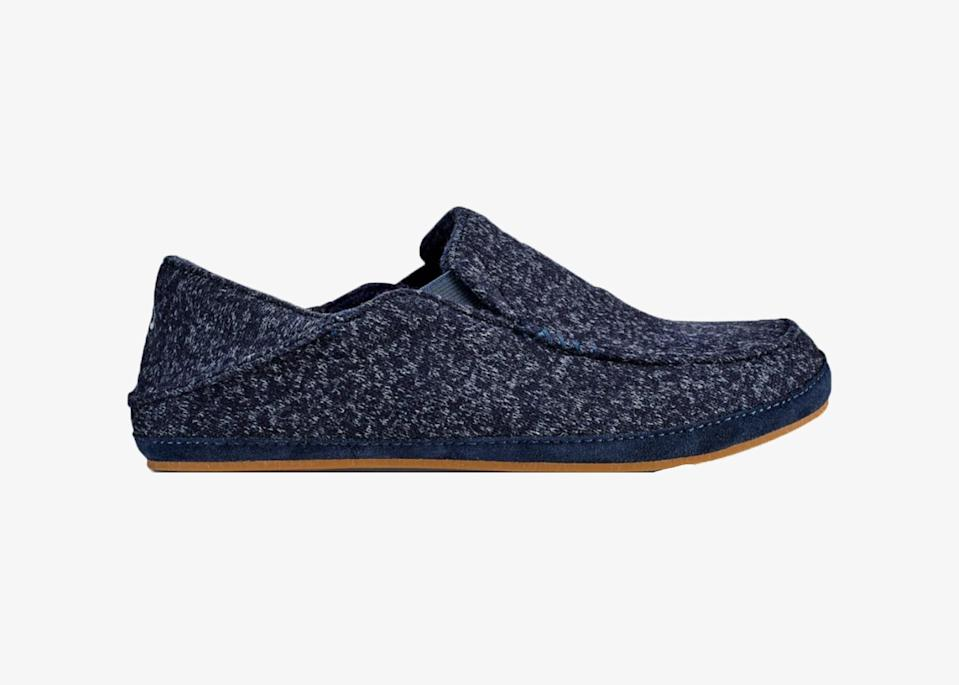 """Loosely inspired by Hawaiian footwear designs, Olukai creates shoes made with biomechanically engineered footbeds that offer lateral arch support and foot mobility. The Moloā Hulu comes with a soft heathered knit upper, wool blend lining, and suede leather foxing. A portion of the proceeds goes toward the <a href=""""http://www.amaolukaifoundation.org/"""" rel=""""nofollow noopener"""" target=""""_blank"""" data-ylk=""""slk:Ama OluKai Foundation"""" class=""""link rapid-noclick-resp"""">Ama OluKai Foundation</a>'s mission to preserve the traditional culture of Hawai'i. $100, Olukai. <a href=""""https://olukai.com/products/moloa-hulu-mens-wool-blend-slippers-trench-blue"""" rel=""""nofollow noopener"""" target=""""_blank"""" data-ylk=""""slk:Get it now!"""" class=""""link rapid-noclick-resp"""">Get it now!</a>"""