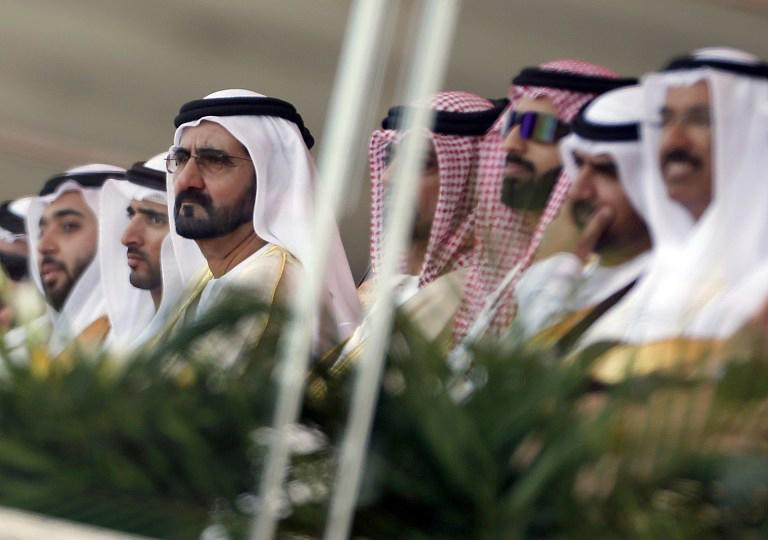 United Arab Emirates' Vice President and Prime Minister, and Ruler of Dubai, Sheikh Mohammed bin Rashid al-Maktoum attend the opening ceremony of the International Defence Exhibition and Conference (IDEX) at the Abu Dhabi National Exhibition Centre in the Emirati capital on February 17, 2013.