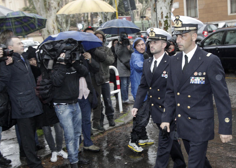 Italian marines Salvatore Girone, left, and Massimiliano Latorre, arrive at a military prosecutor's office in Rome Wednesday, March 20, 2013. A military prosecutor in Rome is questioning the two Italian marines India is insisting return to face trial in the deaths of two fishermen. India's Supreme Court barred the Italian ambassador from leaving the country after the Italian government refused to return the marines to India. The two have been charged in India with killing two Indian fishermen whom the marines say they mistook for pirates. (AP Photo/Riccardo De Luca)