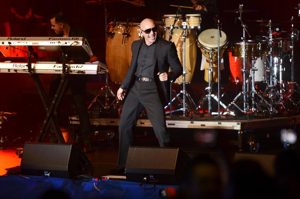 NEW ORLEANS, LA - FEBRUARY 01:  Rapper Pitbull performs onstage at the Rolling Stone LIVE party held at the Bud Light Hotel on February 1, 2013 in New Orleans, Louisiana.  (Photo by Stephen Lovekin/Getty Images for Bud Light)