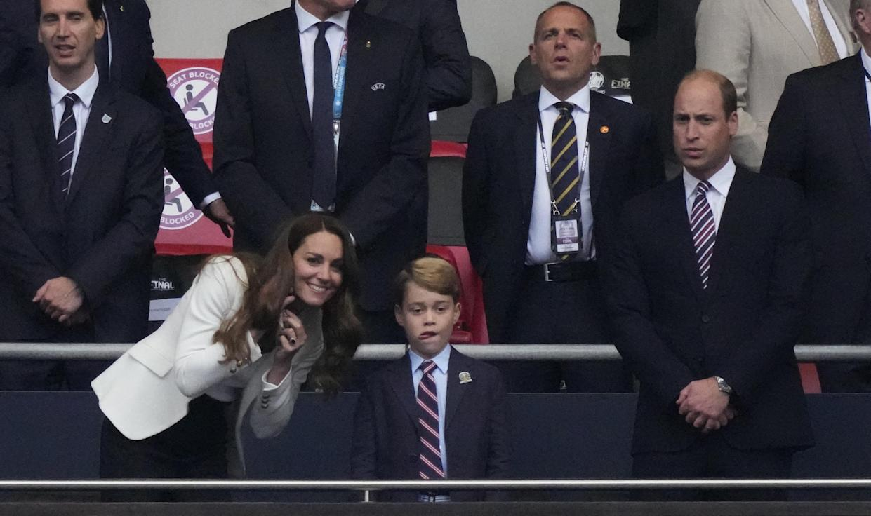 Britain's Catherine (L), Duchess of Cambridge, Prince George of Cambridge (C), and Britain's Prince William (R), Duke of Cambridge, are seen during the UEFA EURO 2020 final football match between Italy and England at the Wembley Stadium in London on July 11, 2021. (Photo by Frank Augstein / POOL / AFP) (Photo by FRANK AUGSTEIN/POOL/AFP via Getty Images)
