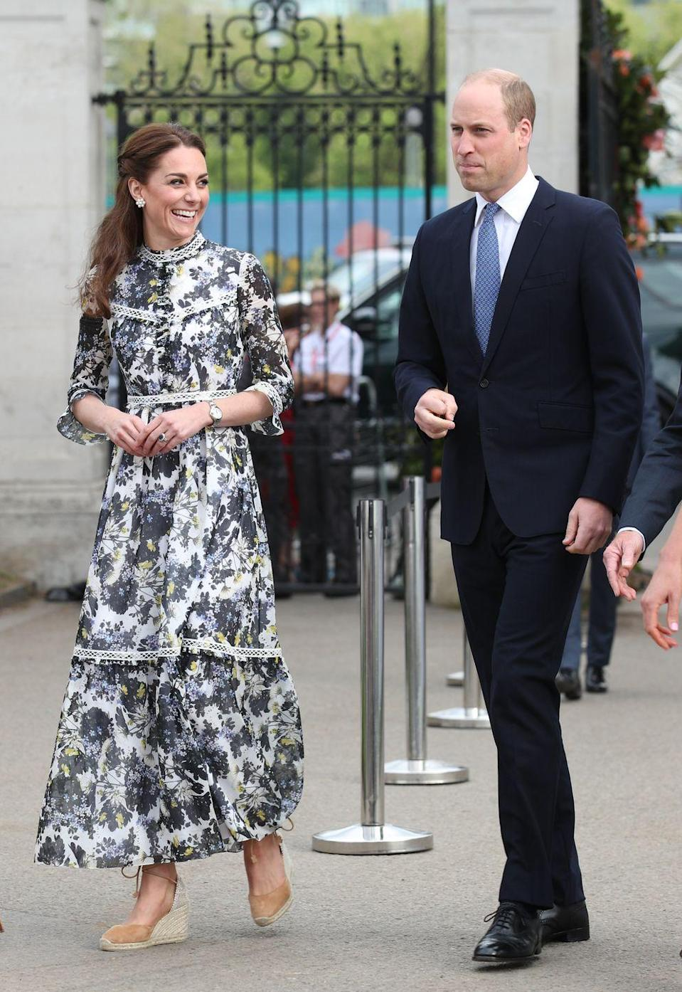 "<p>To show her husband and mother-in-law (also known as Prince William and Queen Elizabeth, respectively) around the garden she helped design for <a href=""//www.townandcountrymag.com/style/fashion-trends/a27510425/kate-middleton-superga-sneakers-massimo-dutti-chelsea-flower-show-2019/"" data-ylk=""slk:2019's Chelsea Flower Show"" class=""link rapid-noclick-resp"">2019's Chelsea Flower Show</a>, Kate paired casual-chic heels with a (naturally) floral printed dress.</p>"