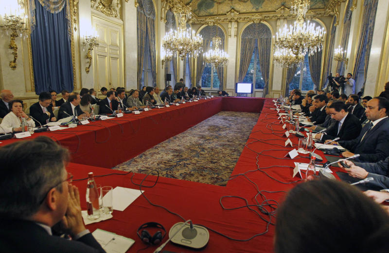 Delegates gather at the start of a conference of representatives of Syrian rebels, at the Quai d'Orsay in Paris, Wednesday, Oct. 17, 2012. Delegates of Syrian revolutionary councils are meeting in Paris Wednesday with officials from some 20 countries to plan an expansion of a French initiative of direct aid to beleaguered rebel-held towns in Syria. (AP Photo/Remy de la Mauviniere)
