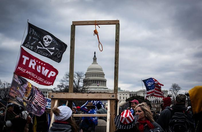 """<span class=""""caption"""">Crowds carrying hate symbols as they stormed the U.S Capitol on Jan. 6 in Washington, D.C.</span> <span class=""""attribution""""><a class=""""link rapid-noclick-resp"""" href=""""https://www.gettyimages.com/detail/news-photo/trump-supporters-near-the-u-s-capitol-on-january-06-2021-in-news-photo/1230476983?adppopup=true"""" rel=""""nofollow noopener"""" target=""""_blank"""" data-ylk=""""slk:Shay Horse/NurPhoto via Getty Images"""">Shay Horse/NurPhoto via Getty Images</a></span>"""
