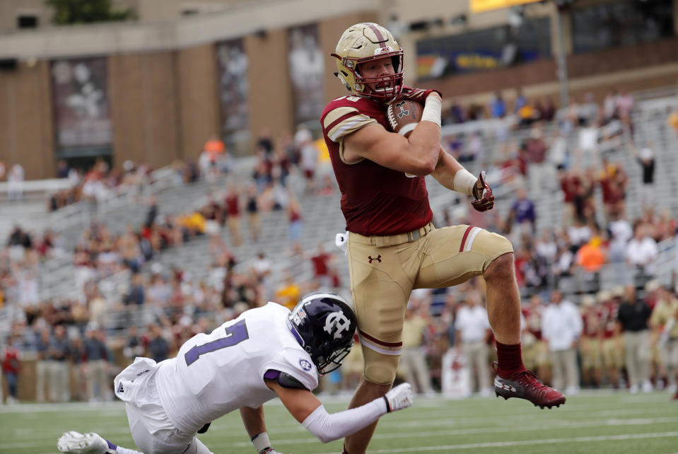 CHESTNUT HILL, MA - SEPTEMBER 08: Boston College tight end Hunter Long (80) scores a touchdown as Holy Cross defensive back Chris Riley (7) tries to stop him during a game between the Boston College Eagles and the Holy Cross Crusaders on September 8, 2018, at Alumni Stadium in Chestnut Hill, Massachusetts. The Eagles defeated the Crusaders 62-14. (Photo by Fred Kfoury III/Icon Sportswire via Getty Images)