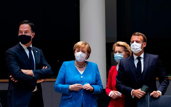 From left: Mark Rutte with Angela Merkel, Ursula von der Leyen, the president of the European Commission, and Mr Macron at the summit. - Francisco Seco / POOL / AFP