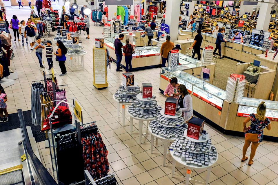 Shoppers walk around looking for Black Friday sale items at a Sears store in Hialeah, Florida, U.S., November 29, 2019. REUTERS/Maria Alejandra Cardona