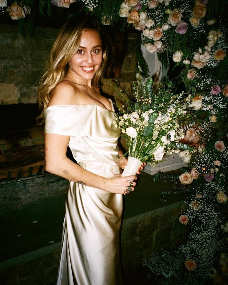 Happy: Miley Cyrus shared a beautiful snap of her on her wedding day to Liam Hemsworth (Miley Cyrus/Instagram)