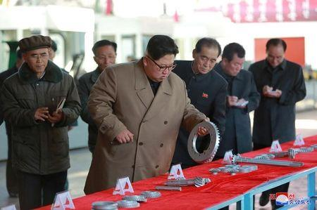 North Korean leader Kim Jong Un gives field guidance to the Kumsong Tractor Factory in this undated picture provided by KCNA in Pyongyang on November 15, 2017. KCNA via Reuters