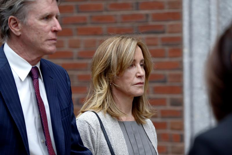 Actor Felicity Huffman, accompanied by her brother Moore Huffman Jr., leaves the federal courthouse after facing charges in a nationwide college admissions cheating scheme in Boston, Massachusetts, U.S., May 13, 2019. REUTERS/Katherine Taylor