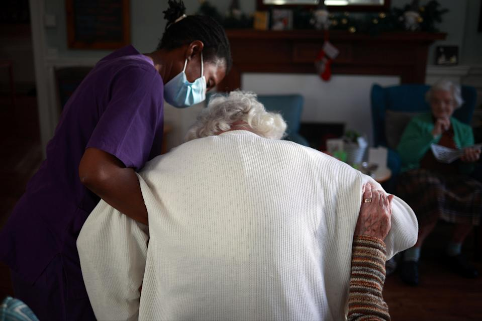 A care worker assists a residentREUTERS