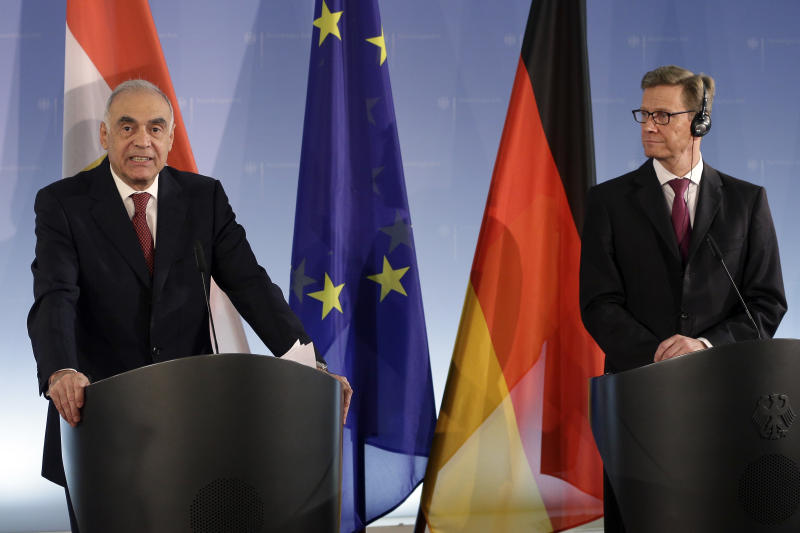 German Foreign Minister Guido Westerwelle, right, and his counterpart from Egypt, Kamel Amr, left, address the media during a joint press conference at the Foreign Office in Berlin, Germany, Thursday, Nov. 29, 2012. (AP Photo/Michael Sohn)