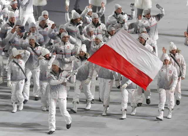 Poland's flag-bearer Dawid Kupczyk leads his country's contingent during the opening ceremony of the 2014 Sochi Winter Olympics, February 7, 2014. REUTERS/Mark Blinch (RUSSIA - Tags: OLYMPICS SPORT)