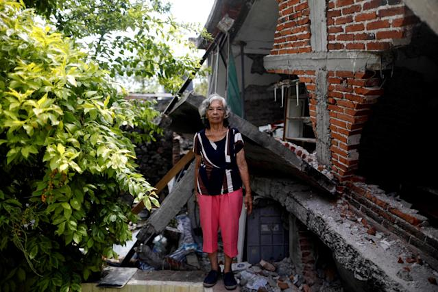 "<p>Cenobia Riquelme, 76, a housewife who suffers from Alzheimer's, poses for a portrait next to her house after an earthquake in Jojutla de Juarez, Mexico, September 29, 2017. Riquelme's house was very badly damaged and her husband was killed. She and her husband were crushed by the rubble. Her husband could not be rescued, but Cenobia was rescued by a soldier. She is living in the backyard and could return to home once it's rebuilt. Her son Sebastian (not pictured) said: ""My mother searches for my father to make his lunch. This is all very sad and I am worried."" (Photo: Edgard Garrido/Reuters) </p>"